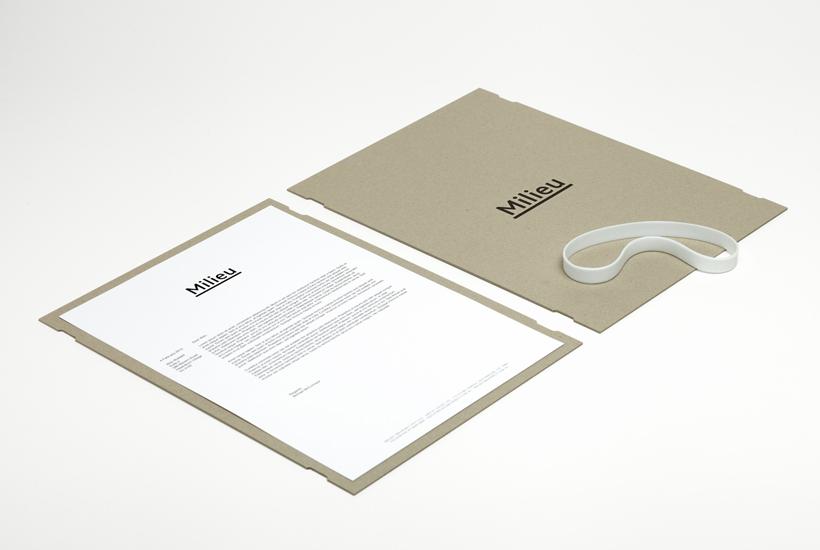Uncoated folder with deboss logo and rubber band detail designed by Hi Ho for Melbourne-based boutique developer Milieu