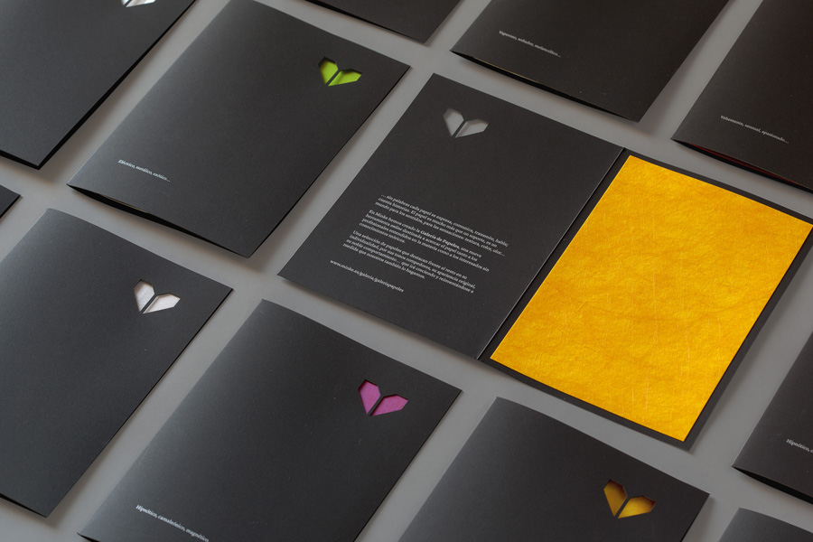 Minke paper sample folders with die cut window, black paper and white ink detail designed by Atipo