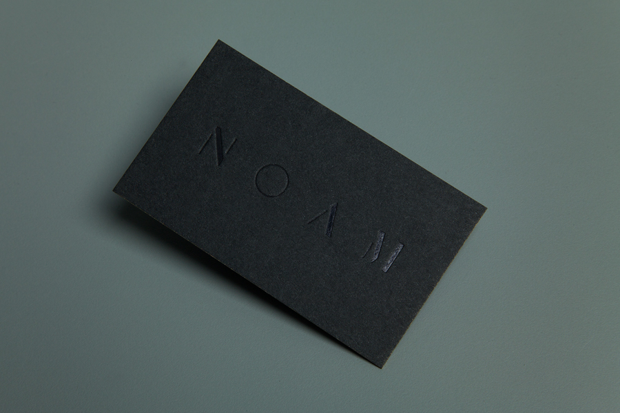 Black business card design with black foil detail by Graphical House for interior design studio Noam