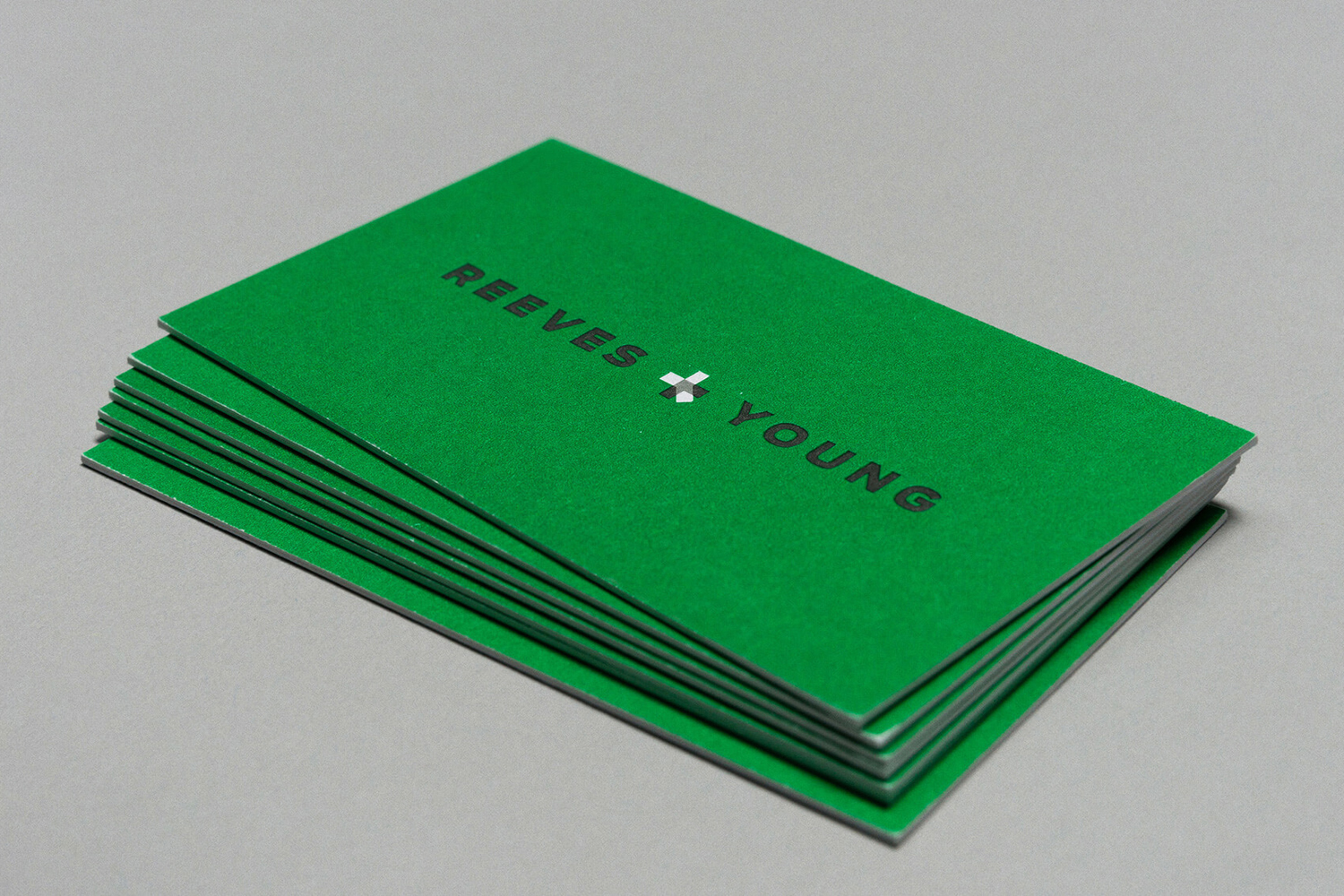 Bright spot green business cards for Reeves & Young designed by Matchstic