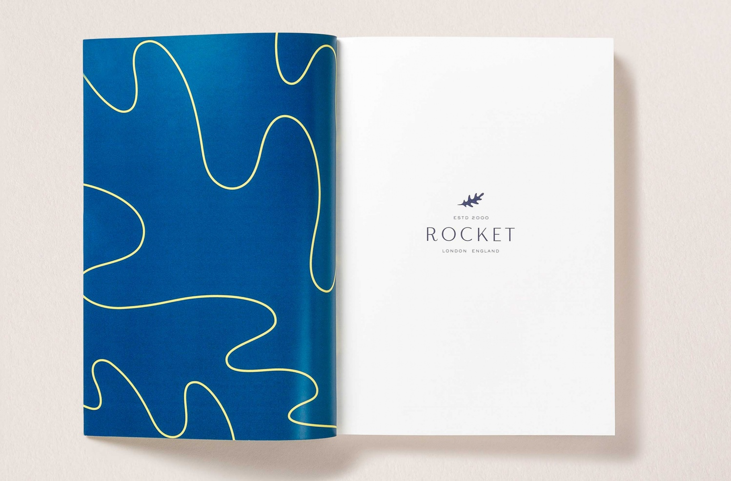 Logo, pattern, stationery and van livery by London-based studio Here Design for UK catering business Rocket