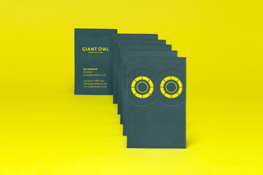 Business card design with green paper, yellow ink and blind emboss detail for production company Giant Owl by Alphabetical