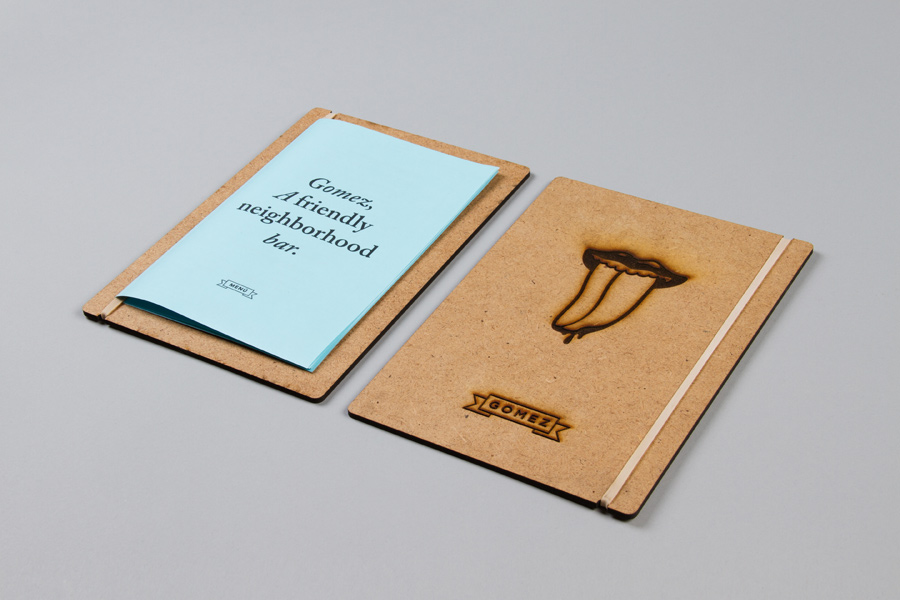 Wood and heat stamped menu with blue paper detail for San Pedro-based bar Gomez designed by Savvy