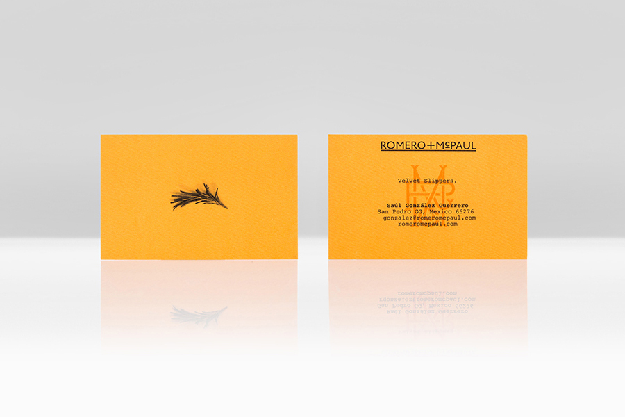 Orange board business card design for velvet slipper retailer Romero+McPaul by Anagrama