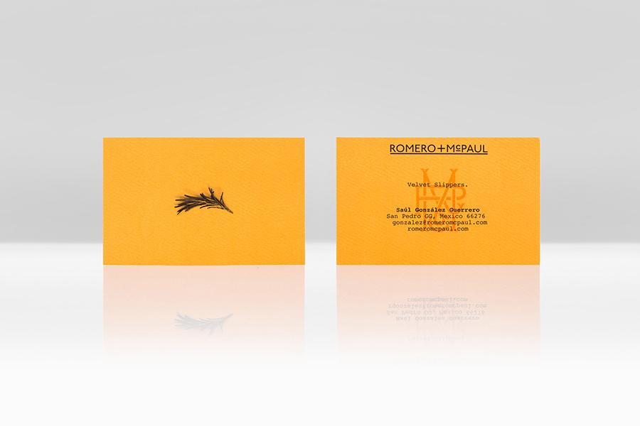 Orange board business card design for velvet slipper retailer Romero+McPaul by Anagrama