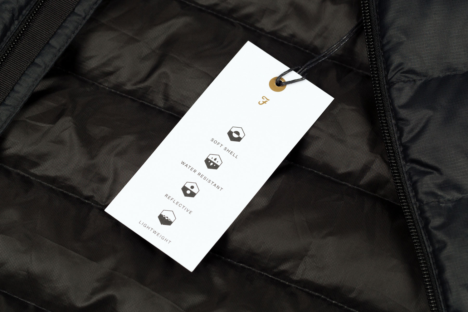 Brand identity and clothing tag with gold ink detail for British fashion brand Farah by graphic design studio Post