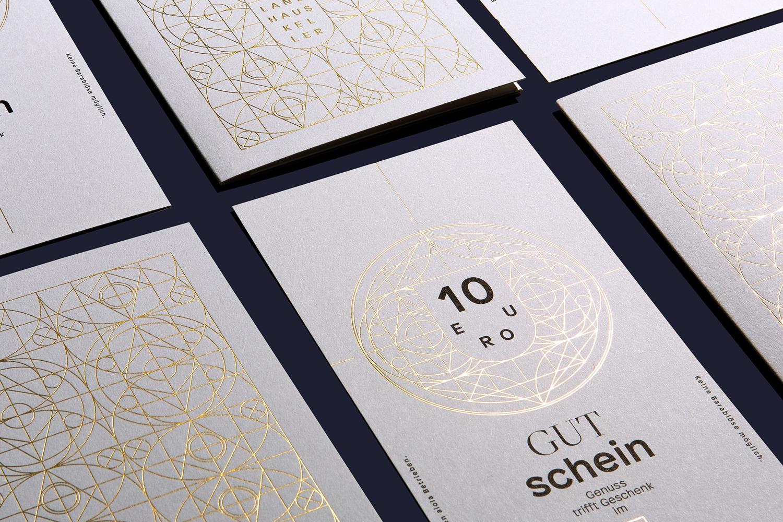 Brand identity and gold foiled print by Austrian graphic design studio Seite Zwei for Graz-based restaurant Landhaus Keller.