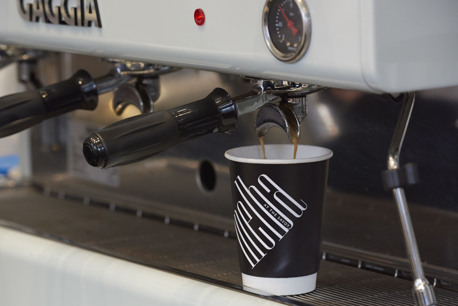 Branded coffee cup designed by Pentagram for London patisserie and cafe Melba at The Savoy