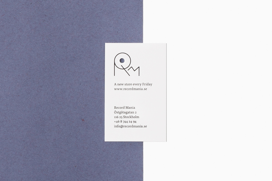 Hole punched business card for Record Mania by Bedow
