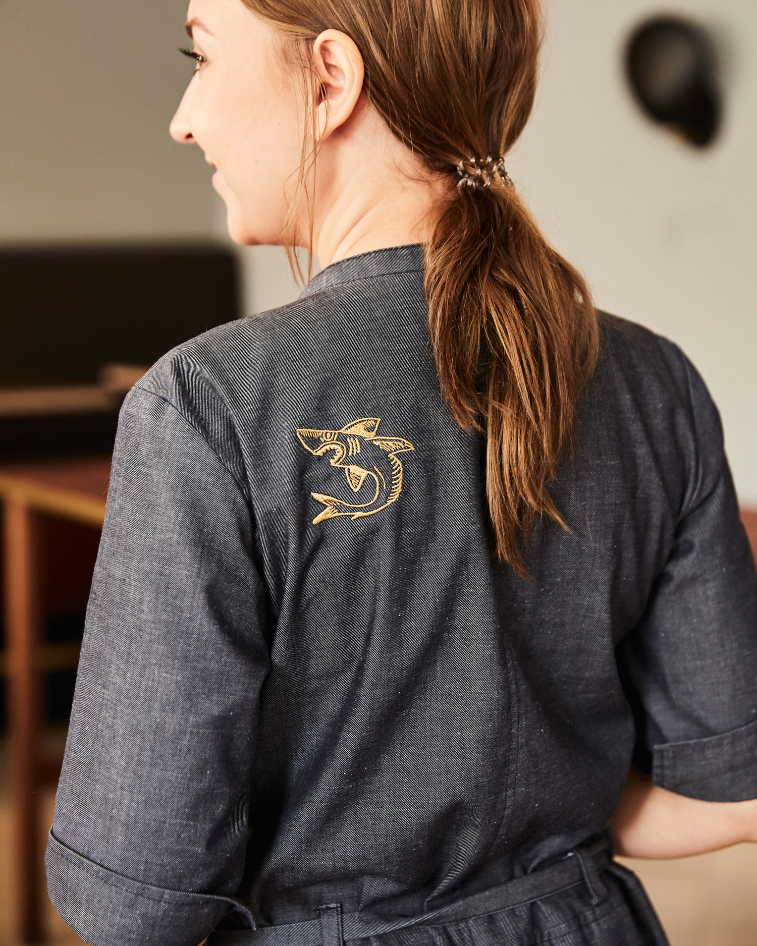 Branding and embroidered uniform by Bond for Helsinki bar and restaurant Roster