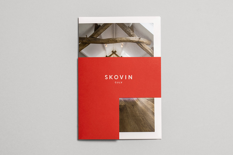 Catalogue with coloured paper and die cut cover designed by Heydays for Norwegian high-end wood flooring supplier Skovin