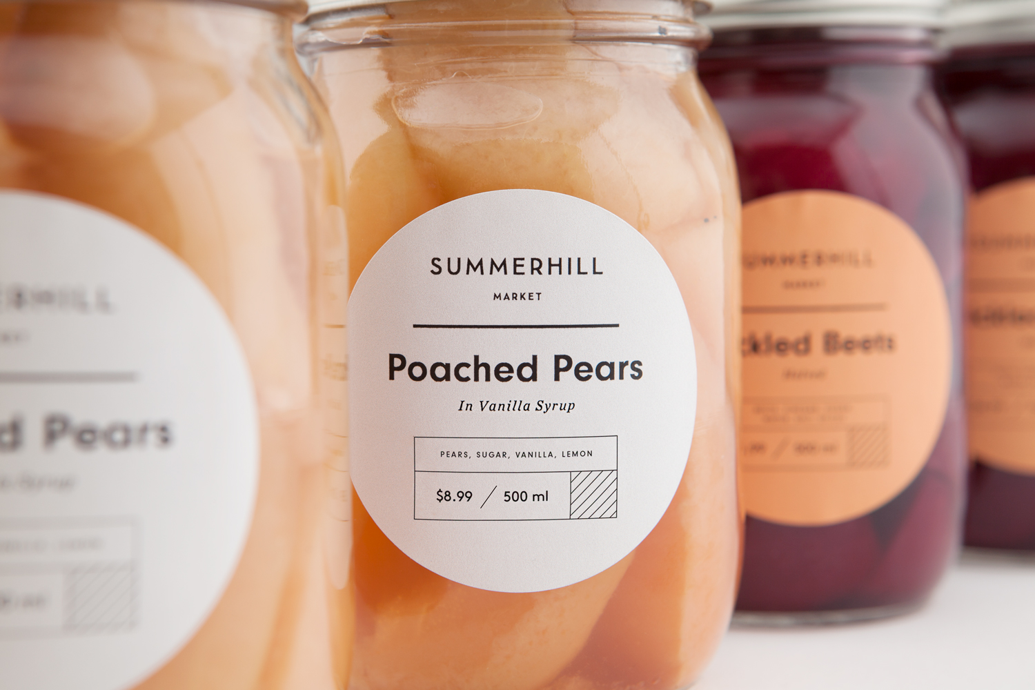 Branding and pear packaging designed by Canadian studio Blok for Toronto based boutique grocery store Summerhill Market