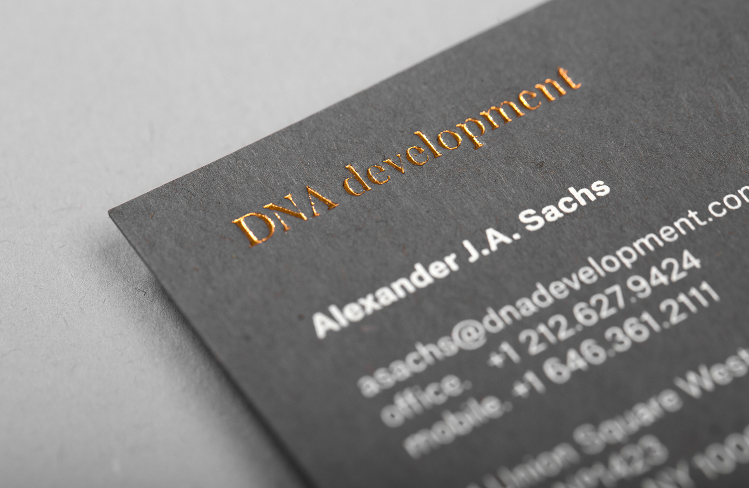 Gold and white block foiled business cards for DNA development designed by Face