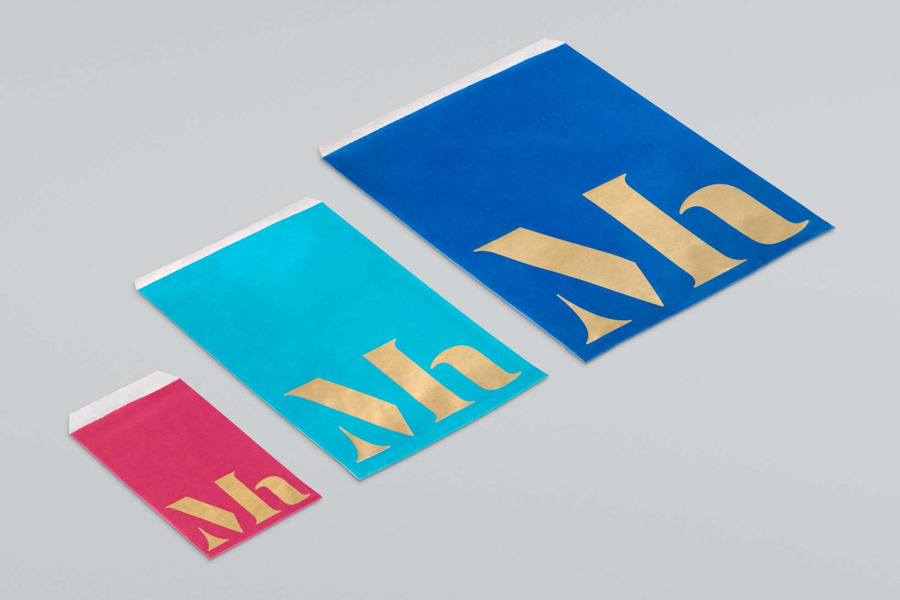 Monogram and print with metallic paper and spot colour detail designed by Dumbar for art museum Mauritshuis