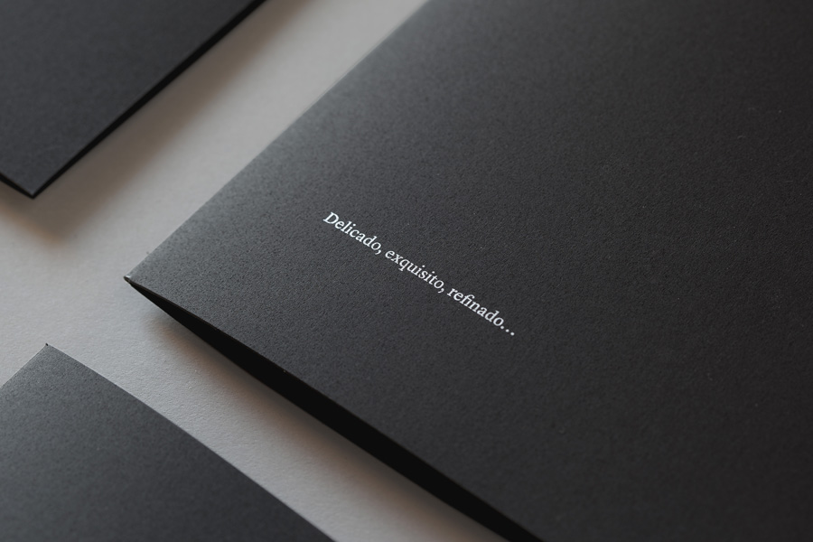 Minke paper sample folders with black card and white ink detail designed by Atipo