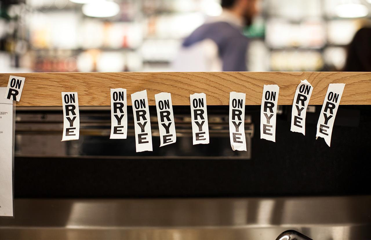Brand identity and sticker design by Pentagram for Washington DC sandwich shop On Rye