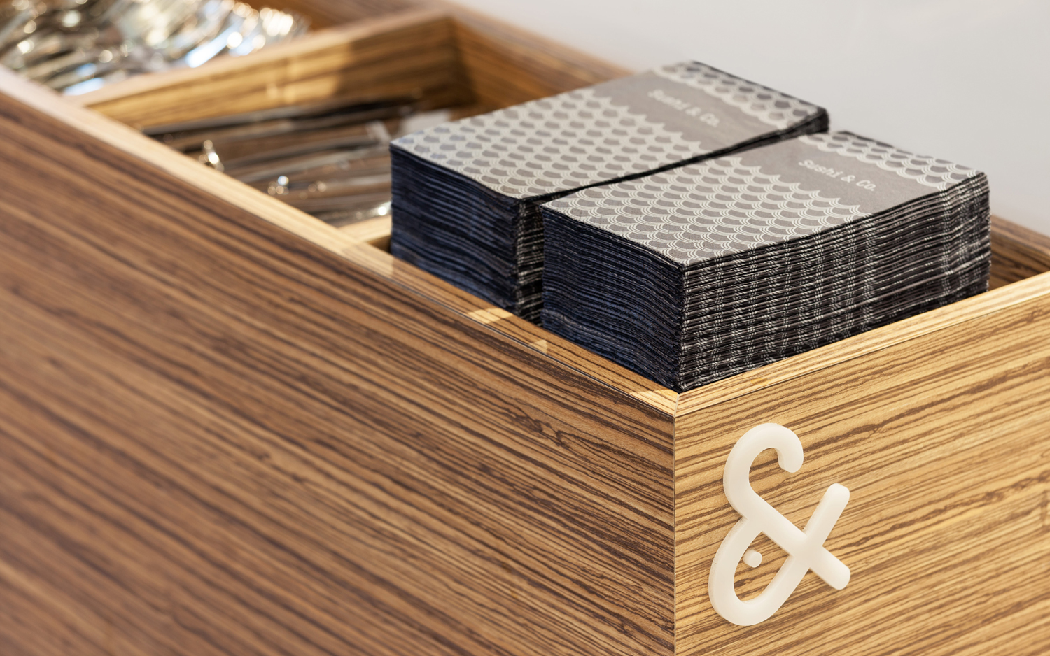 Visual identity and napkins for Baltic Sea cruise ship restaurant Sushi & Co. designed by Bond