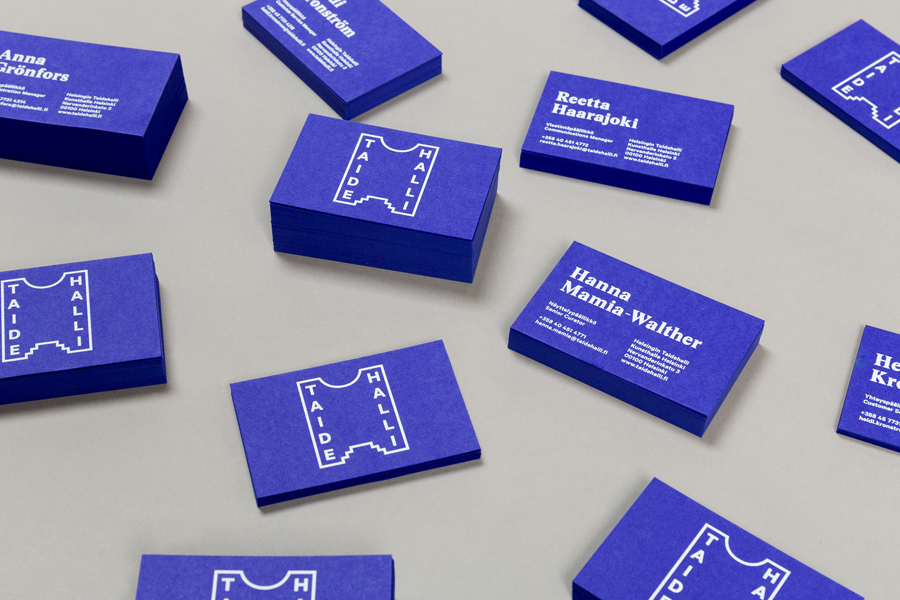 Blue board business cards with white ink detail for Taidehalli designed by Tsto