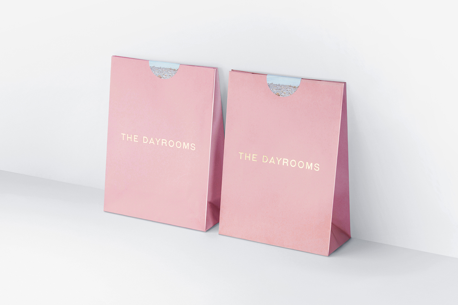 New brand identity for the dayrooms by two times elliott for Millenial pink gifts