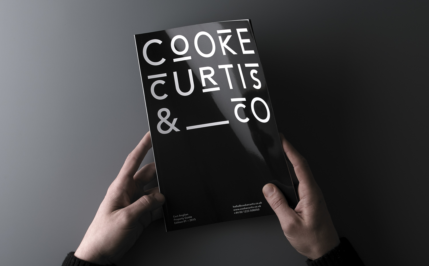 Brand identity and magazine cover for UK estate agent Cooke Curtis & Co. by graphic design studio The District, United Kingdom