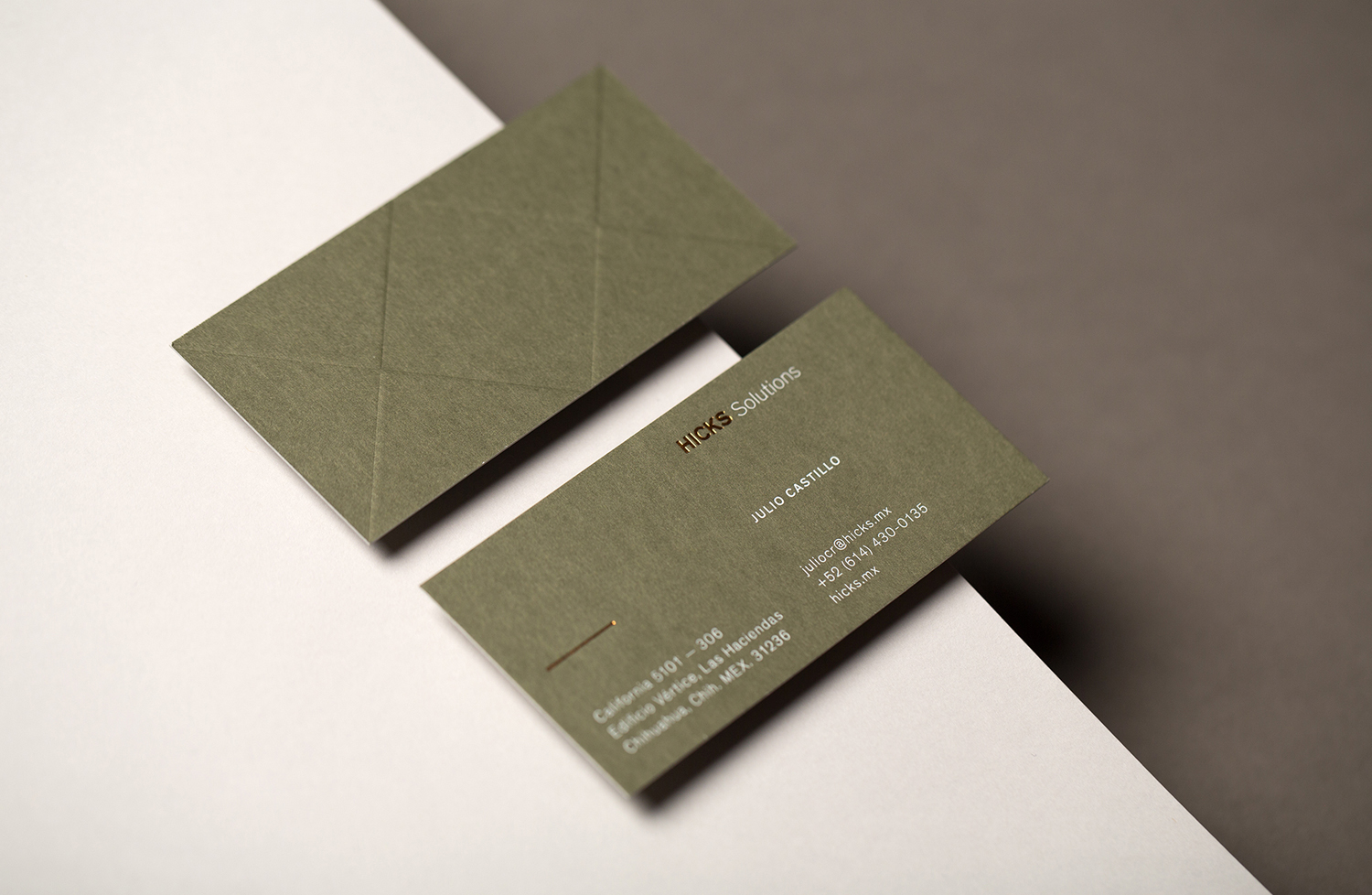 Brand identity and business cards with block foil and blind deboss detail designed by Face for Hicks Solutions.