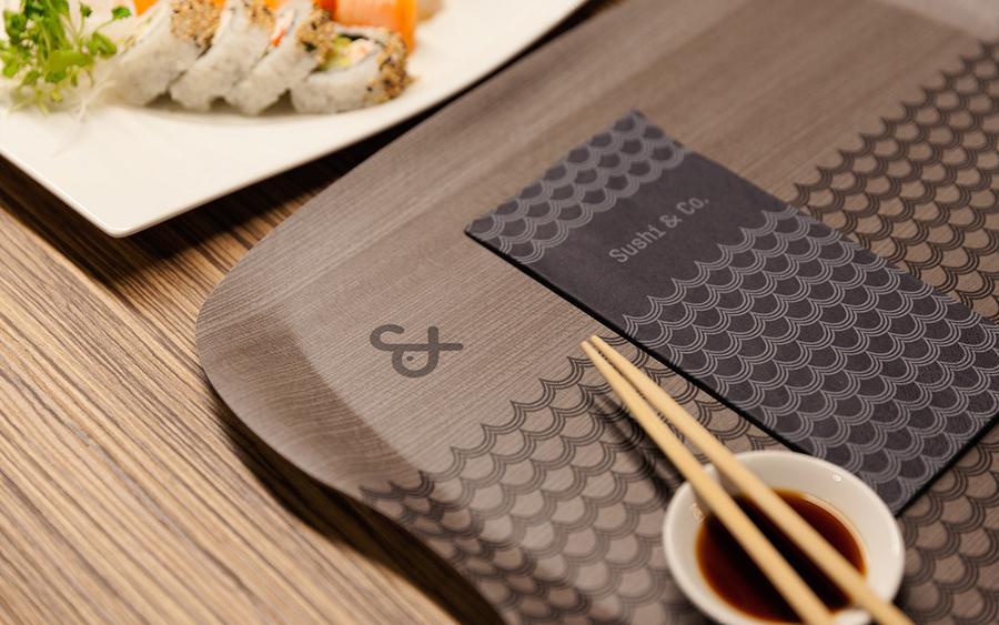 Visual identity, napkins and trays for cruise ship restaurant Sushi & Co. designed by Bond