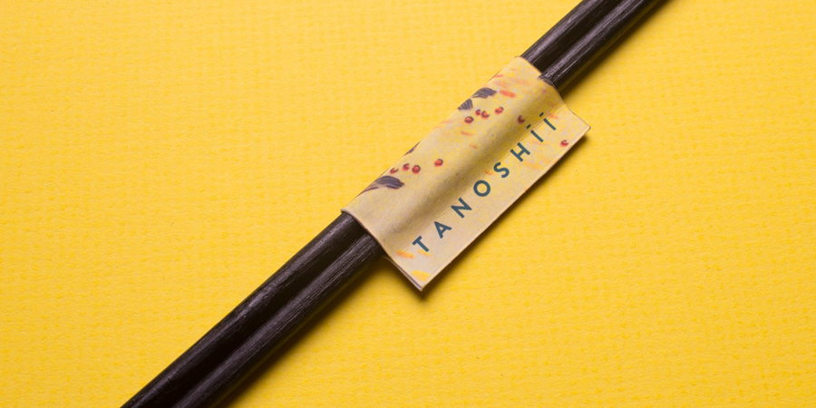 Chopstick label for Dallas based ramen restaurant Tanoshii designed by Mast