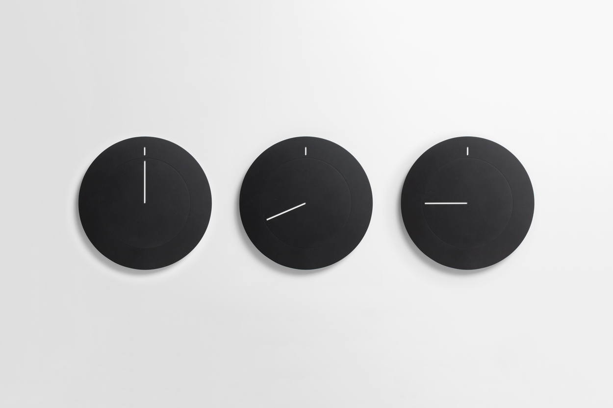 Brand identity and branded wall clocks by Studio South for Auckland luxury apartment complex The International