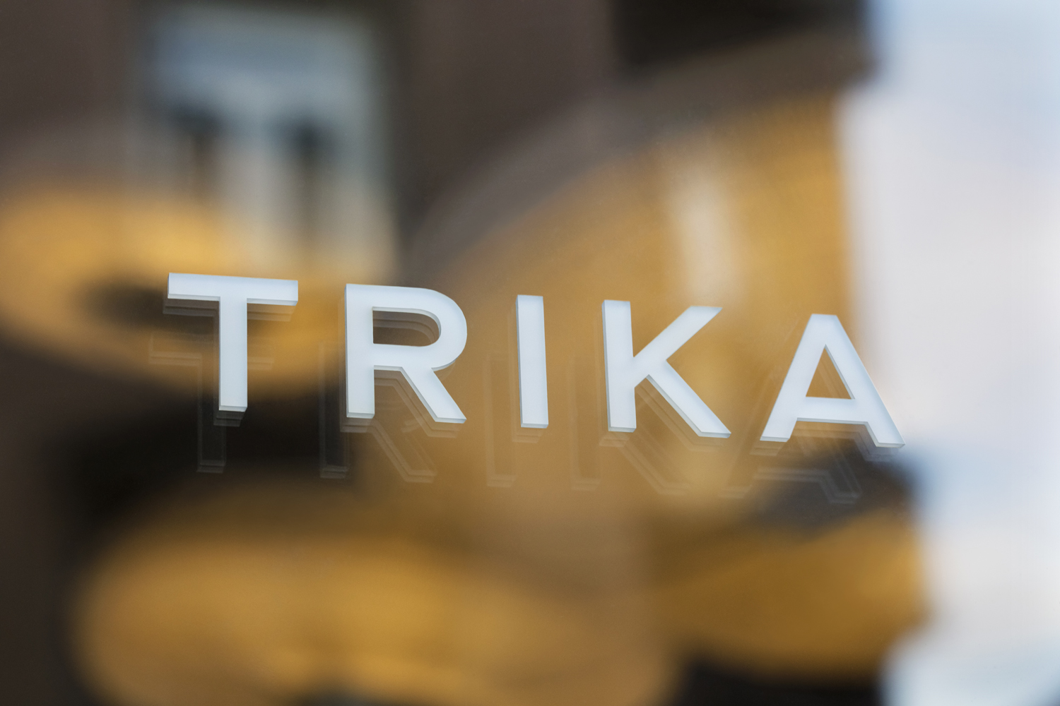 Logotype as signage by UK design studio Bunch for Croatian interior design business Trika