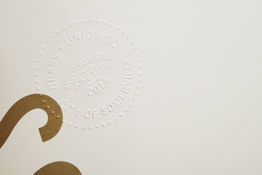 Blind emboss and bronze metallic ink detail for Somerville pub and cocktail bar Brass Union designed by Oat