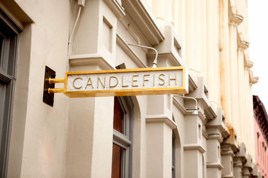 Logo and signage for Charleston handcrafted scented candle store and workshop Candlefish by Fuzzco