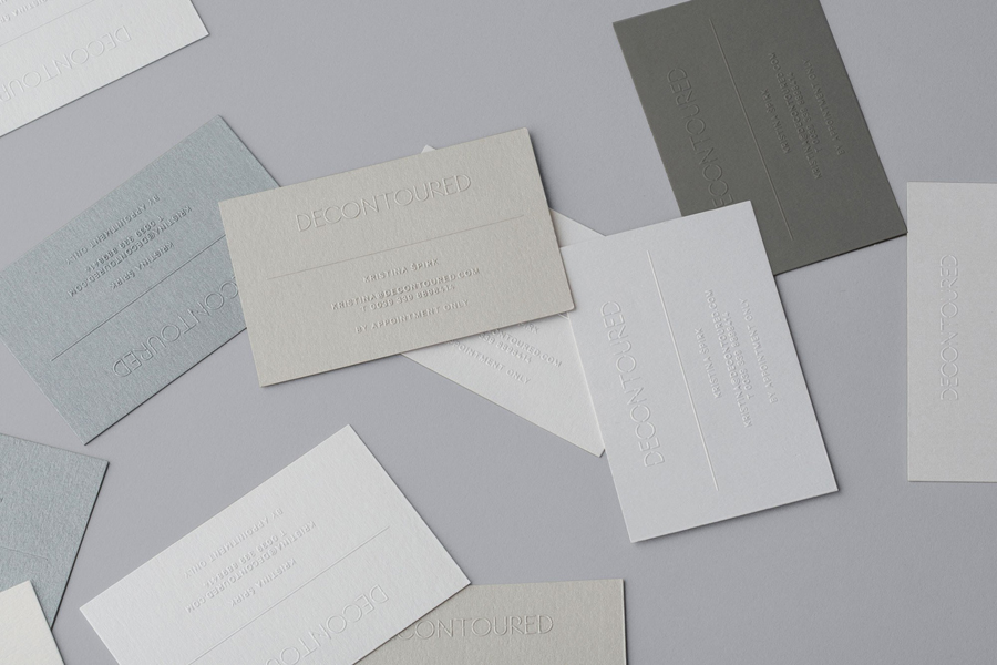 Blind embossed business cards designed by Bunch for Milan based fashion label Decontoured