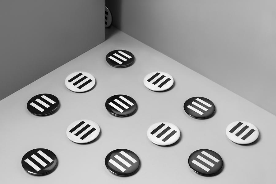 Badges by graphic design studio Lundgren+Lindqvist for Edouard Malingue Gallery
