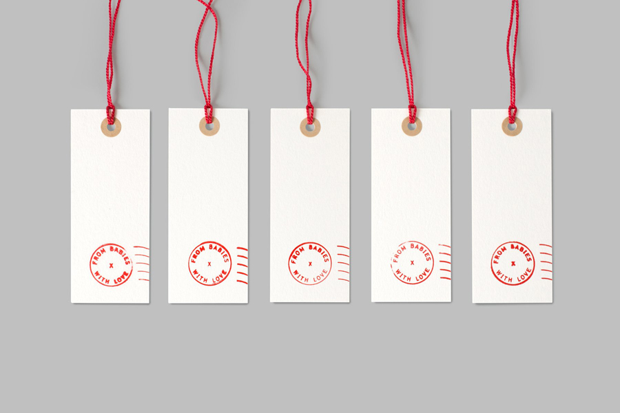Visual identity and tags designed by Paul Belford Ltd. for organic baby clothing business From Babies With Love