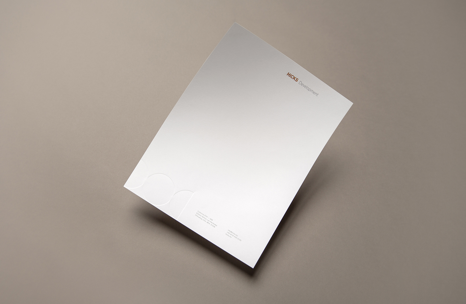 Brand identity and headed paper designed by Face for Mexican real estate group Hicks.