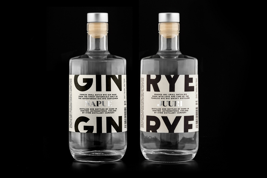 Packaging with laid paper and silver foil detail designed by Werklig for Kyrö Distillery Company