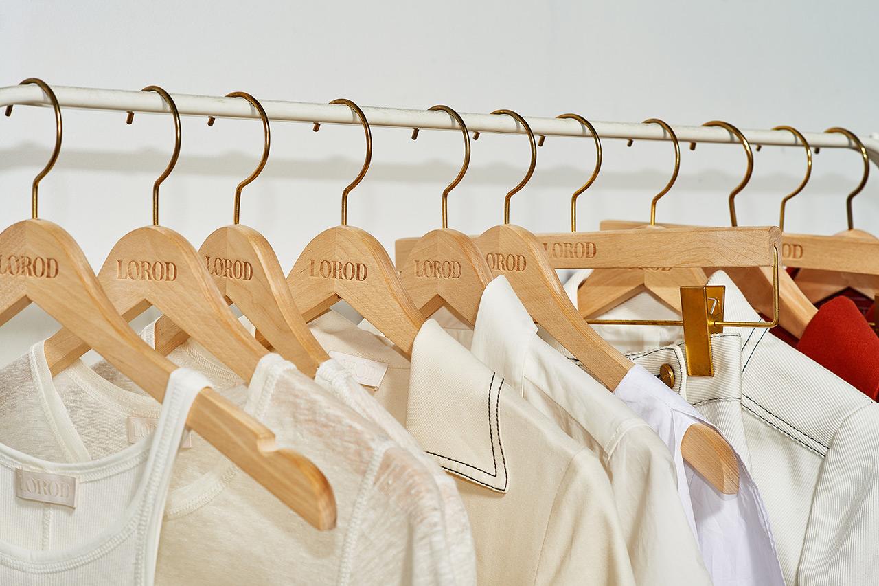 Branded coat hangers by Pentagram's Natasha Jen for fashion brand Lorod.