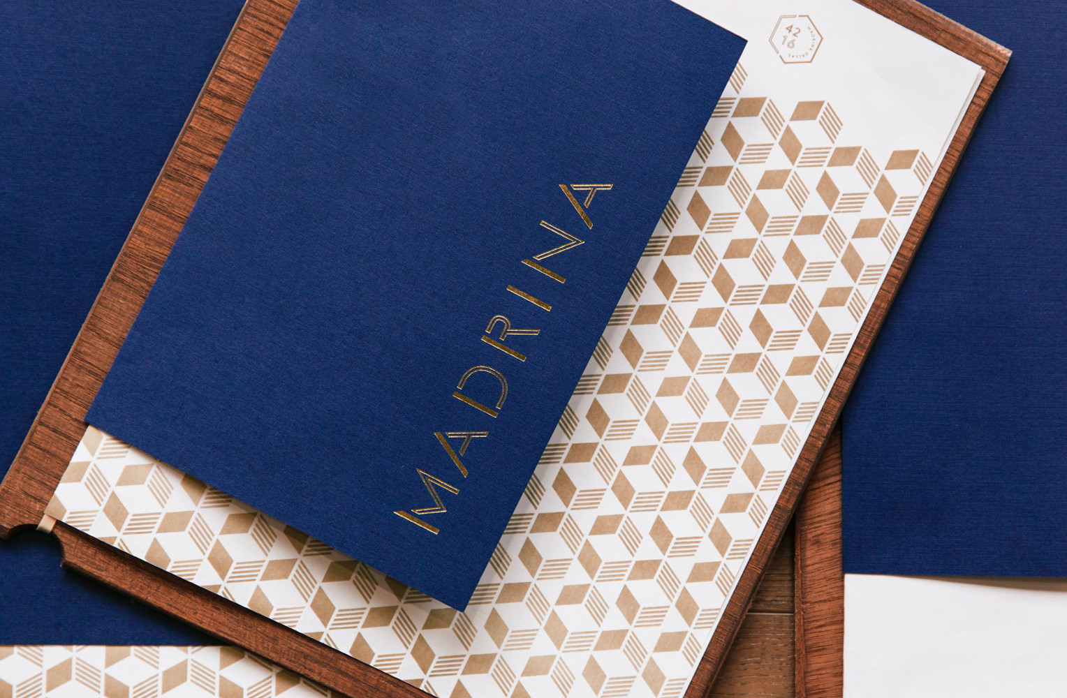 Brand identity and menu with gold foil detail for French inspired Mexican restaurant Madrina designed by Mast