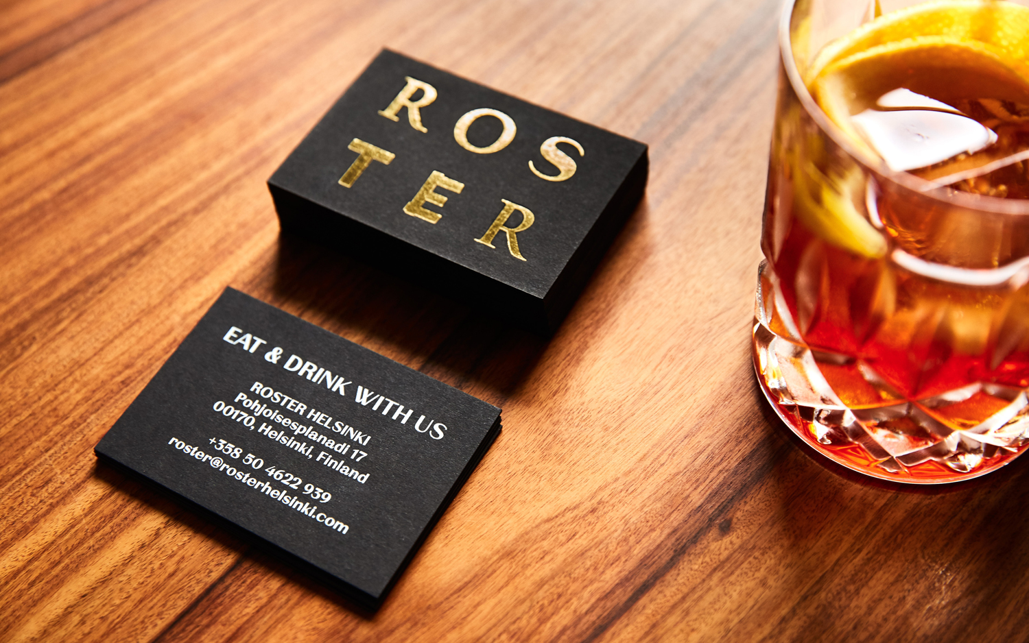 Logotype and gold foiled business cards by Bond for Helsinki bar and restaurant Roster
