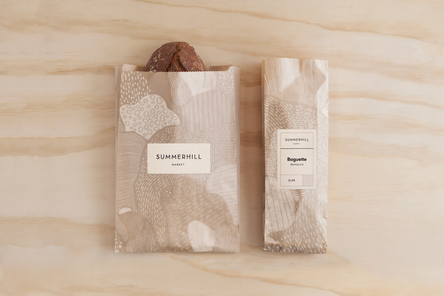 Branding and illustrated bread bags designed by Canadian studio Blok for Toronto based boutique grocery store Summerhill Market