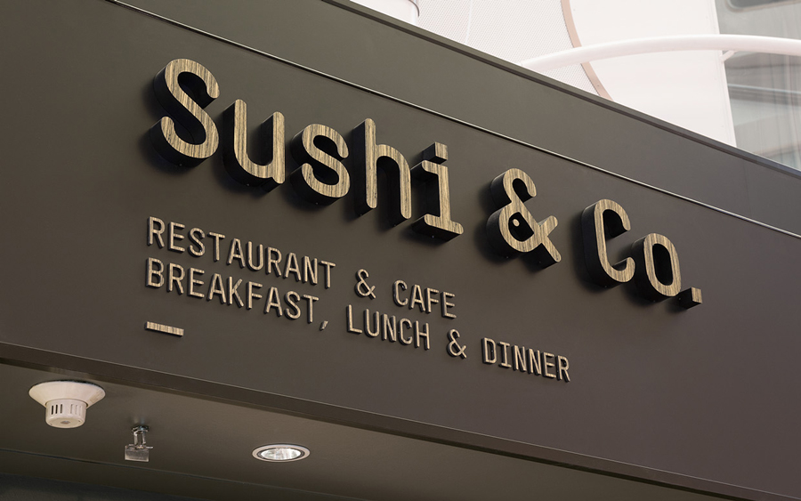 Logo and signage for cruise ship restaurant Sushi & Co. designed by Bond