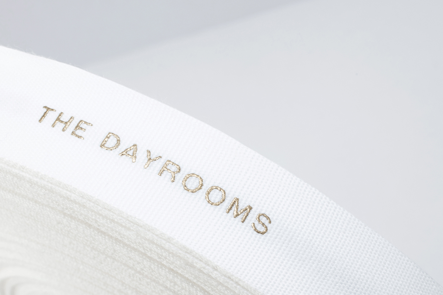 Logotype and branded ribbon with gold ink by Two Times Elliott for Australian fashion boutique in London The Dayrooms