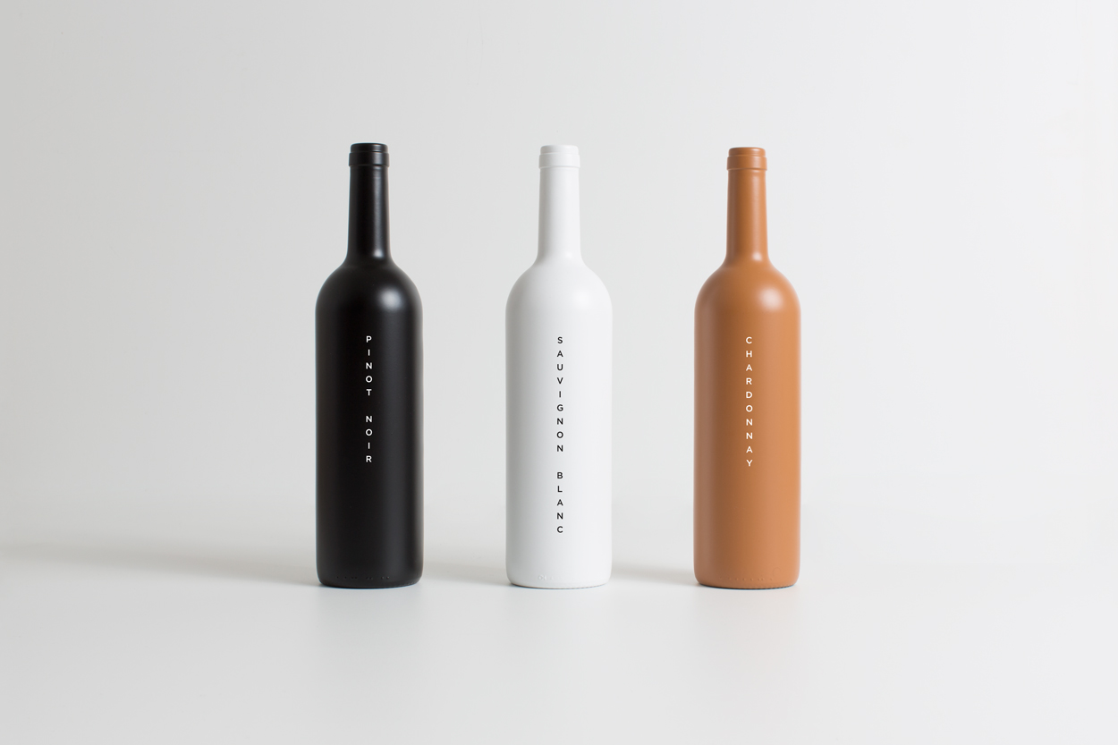Brand identity and branded wine bottles by Studio South for Auckland luxury apartment complex The International