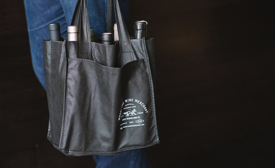 Black screen printed tote bag for Nashville based Woodland Wine Merchant by Perky Bros
