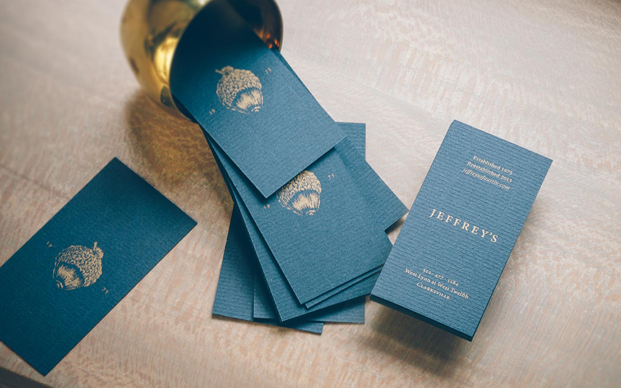 Business card design with gold ink and laid and dyed paper detail for restaurant Jeffrey's of Austin by Foda