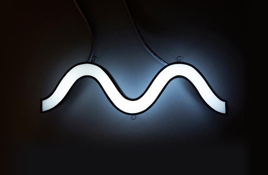Waveform logo as neon signage designed by Face for tour management agency Motion Music