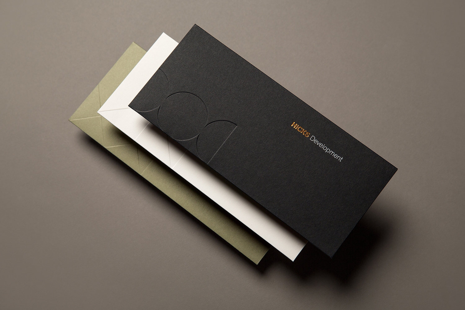 Brand identity and envelopes with block foil and blind deboss detail designed by Face for Mexican real estate group Hicks.