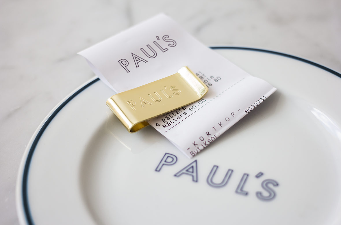 Branded bill clip for Stockholm-based restaurant Paul's at Haymarket by 25AH, Sweden