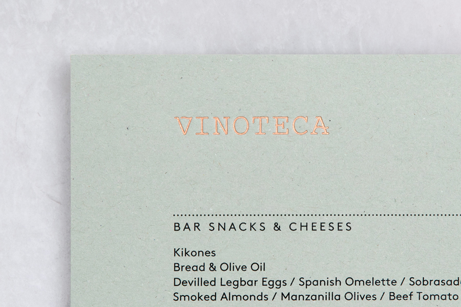 Copper block foiled menu for London restaurant group Vinoteca by British graphic design studio dn&co.