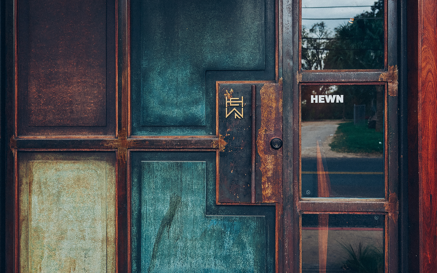 Logo and signage for woodworking shop Hewn designed by Föda, United States
